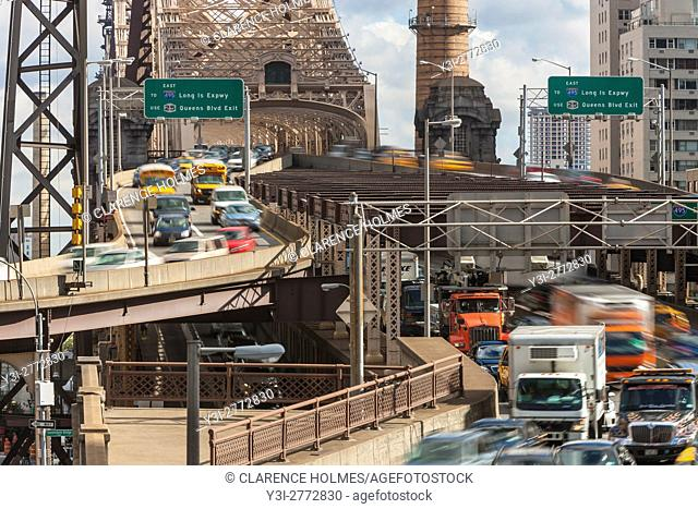 Mid-day traffic enters Manhattan from Queens on the Queensboro Bridge in New York City