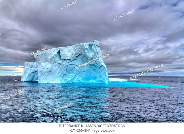 An iceberg in the waters of the Antarctic Peninsula, Antarctica