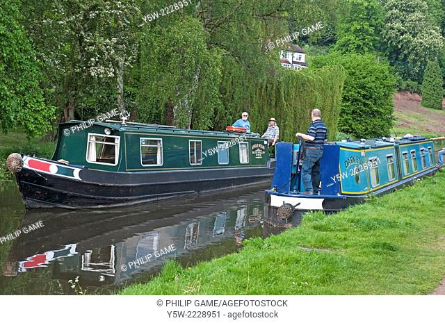 Narrowboats passing along the Staffordshire and Worcestershire Canal in the Black Country, England