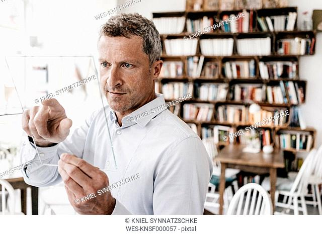 Businessman touching glass screen, future of communication