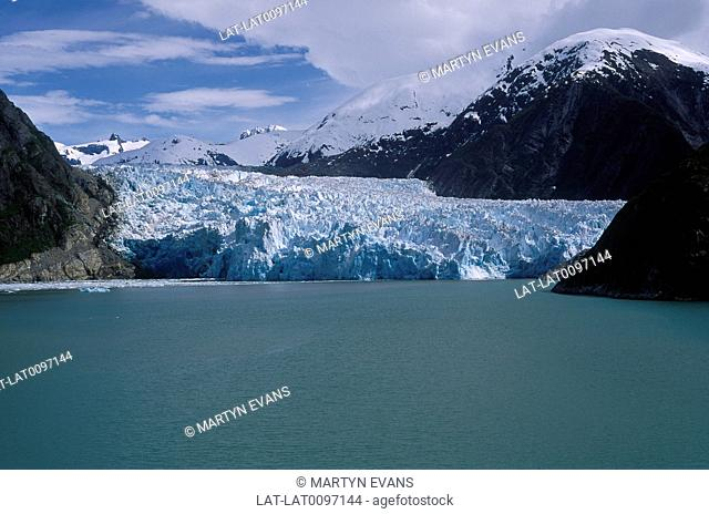 Inlet on coast. Glacier,ice pack. Meeting sea. Opaque blue water