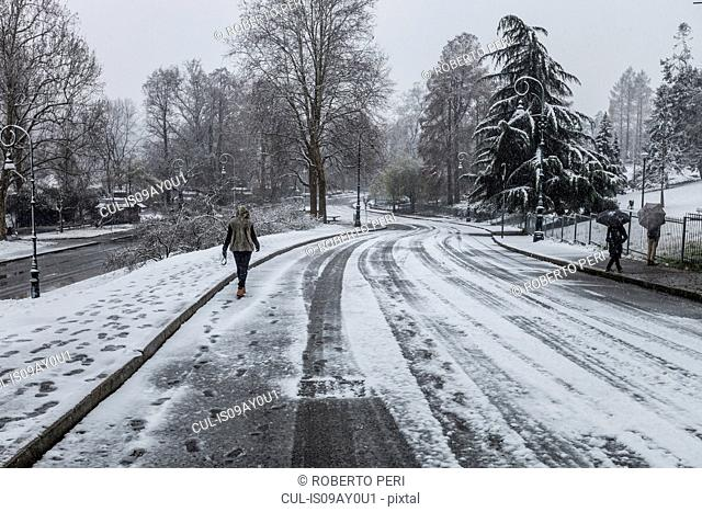 People walking on snow covered road
