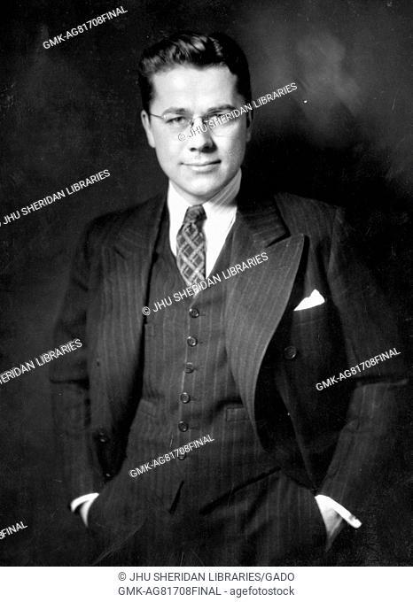 Half length standing portrait of biostatistician and professor John William Fertig, 1940