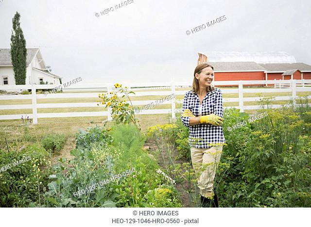 Senior woman standing in farm garden