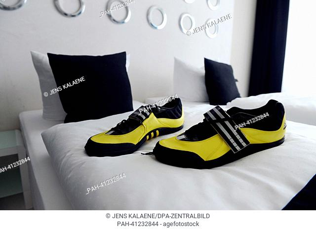 Tennis shoes size 50 from Robert Harting are pictured in the Rober-Harting Suite at the Sport Hotel Kolumbus in Berlin, Germany, 29 May 2013