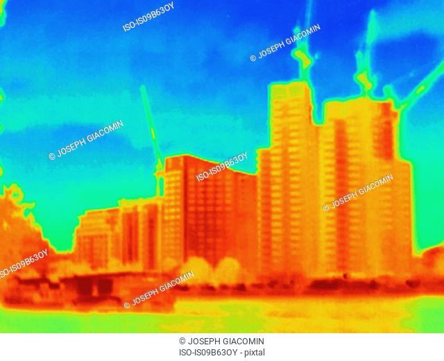 Thermal photograph of skyscrapers and construction cranes, London, UK