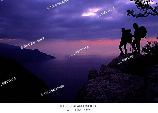 Hikers over Valldemossa. Serra de Tramuntana, Majorca, Balearic Islands, Spain