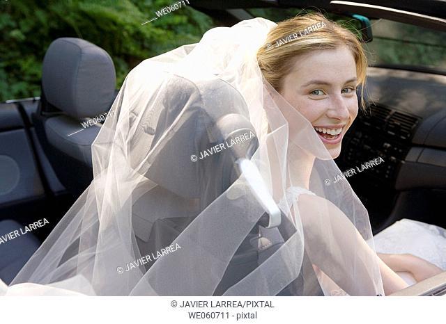 Bride in a convertible