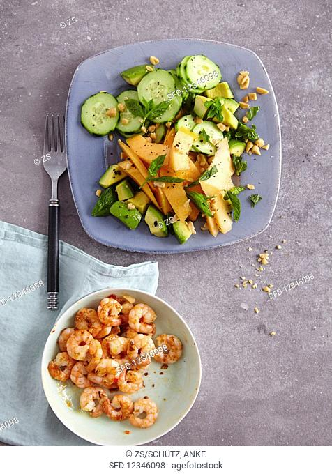 A melon, cucumber and avocado salad - 'Jump in the Pool' - and garlic prawns