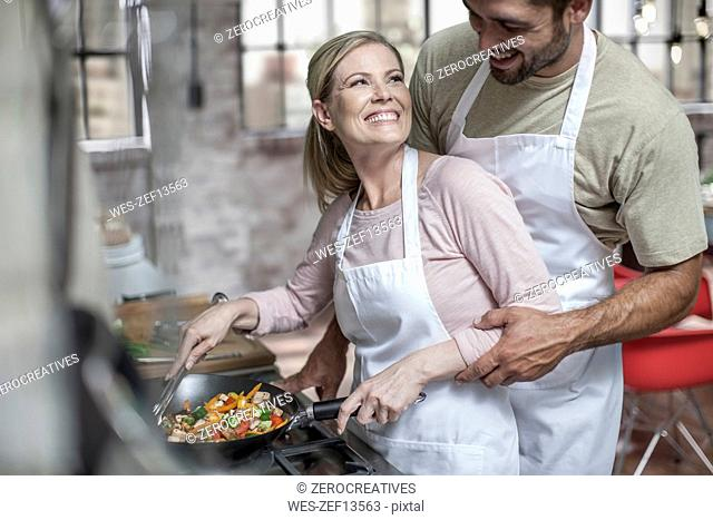 Loving couple preparing healthy food