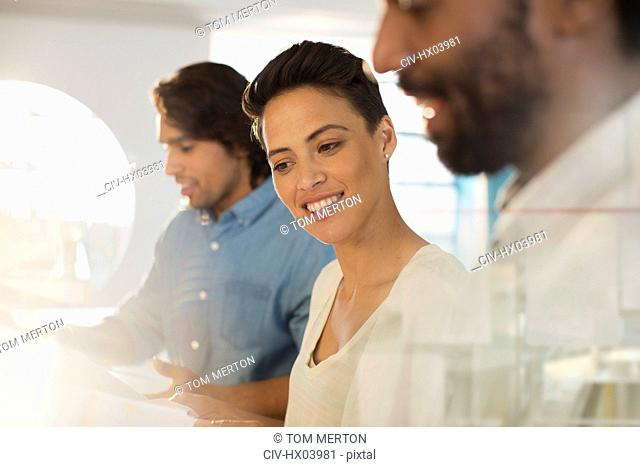 Smiling businesswoman listening to colleague in meeting