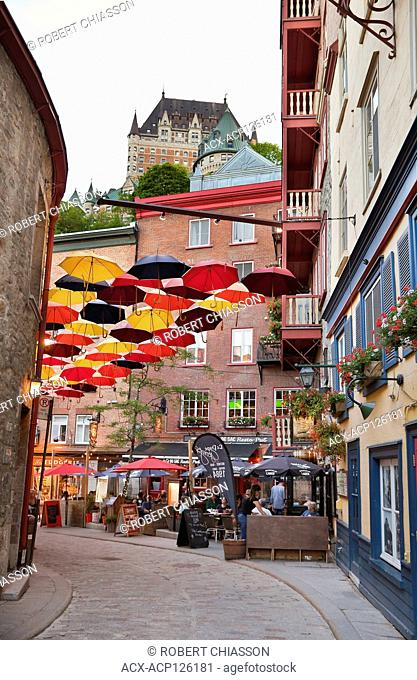 Umbrellas suspended over Rue Sous le Fort (Street Under the Fort) in the Lower Town of Old Quebec City, Province of Quebec, Canada
