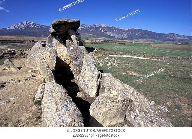La chabola de la Hechicera The Witch's Hut is a dolmen group located in Elvillar, Álava, in the Basque Country in Spain. Three vertical big stones support a big...
