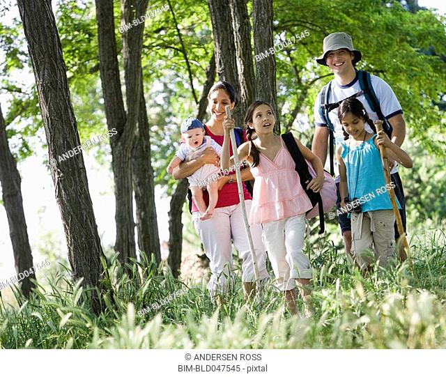 Multi-ethnic family walking in woods