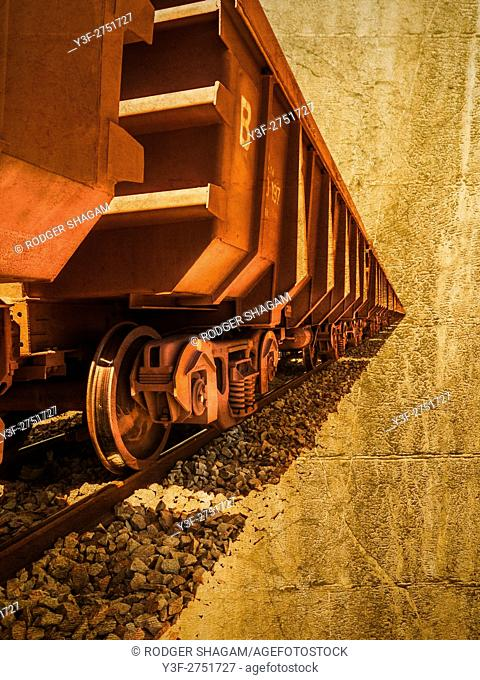 Long iron-ore trains extend to infinity along the railway line. As far as the eye can see!. Western Cape Province, South Africa. With graphic effect