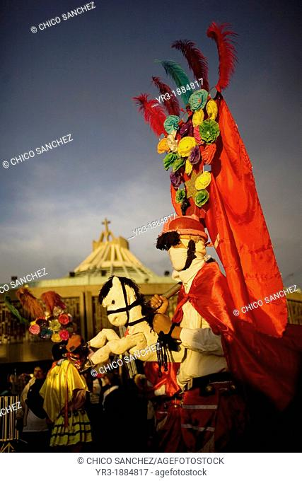 A pilgrim from Tomatlan, Veracruz state, dressed as Saint James apostle performs the Baile de los Santiagos or Saint James's Dance riding a toy horse outside of...