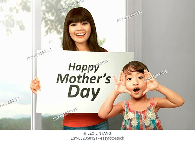 Young asian woman with her sister celebrate happy mother day at home