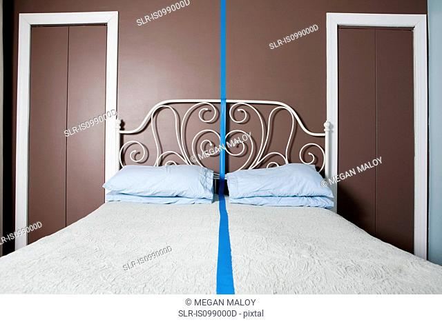 Double bed separated by blue line