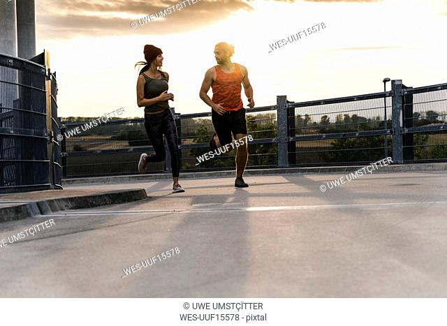 Young couple jogging in the morning