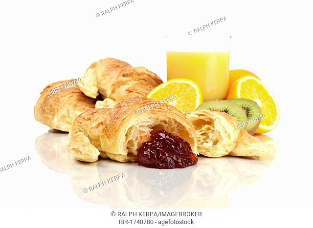 Croissants with strawberry jam, juice and fruit
