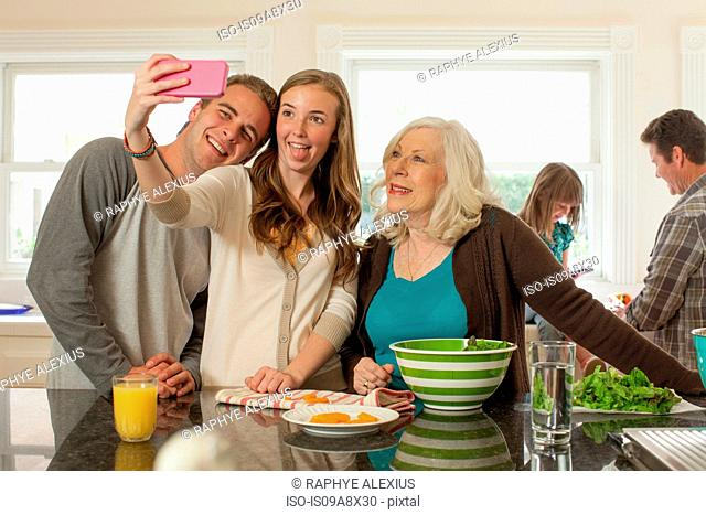 Grandchildren with grandmother photographing themselves