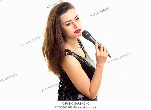 young lady in black dress with microphone isolated on white background