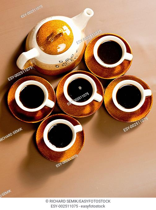 still life of coffee cups and coffeepot