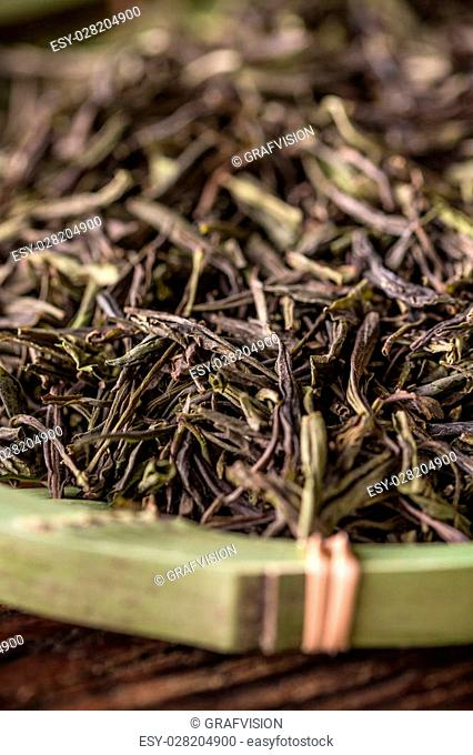 Close up of dry green tea leaves