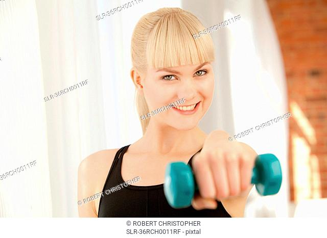 Woman lifting hand weights