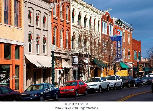 Historic Main Street with Red Brick Storefronts, parked cars and Gray's Pharmacy in Franklin, Tennessee, a suburb south of Nashville, Williamson County, Tenn