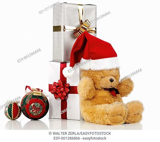 christmas teddy bear with a present