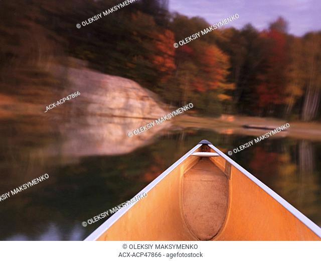 Canoeing on lake George in fall. Killarney Provincial Park, Ontario, Canada