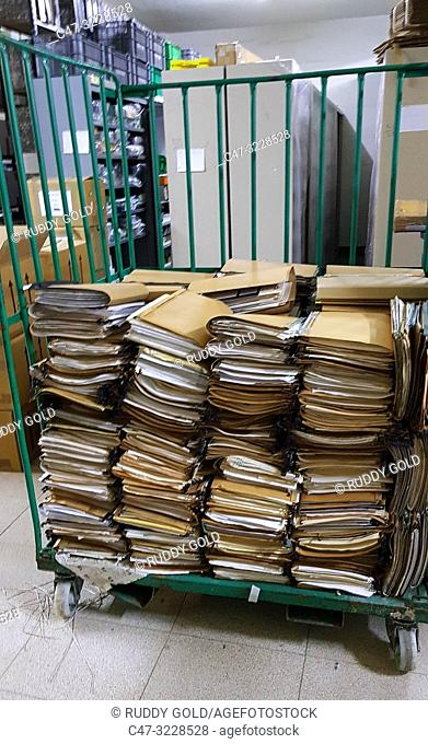 All office file being destroyed after having been scanned for future reference