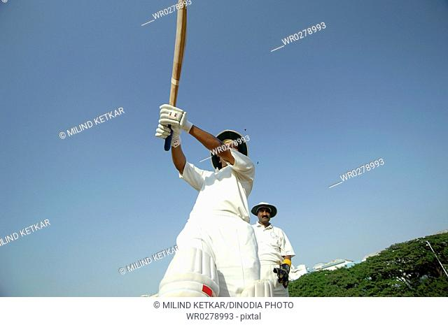 Indian left handed batsman in action playing pull shot in cricket match MR705L