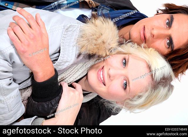 Attractive couple wearing winter coats