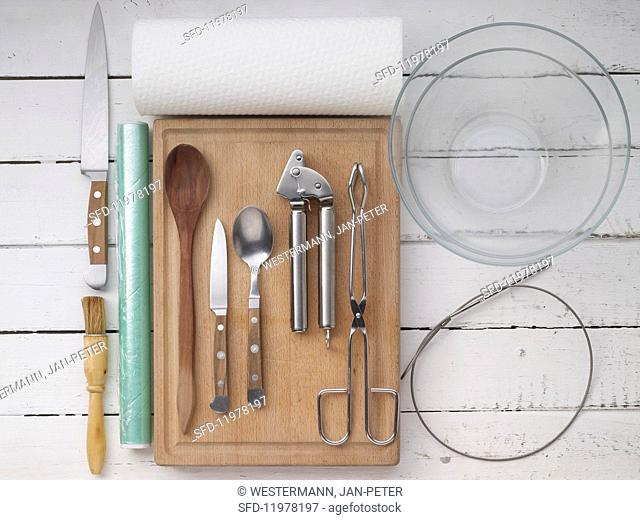Kitchen utensils for making marinated prawn and vegetable kebabs for a barbecue