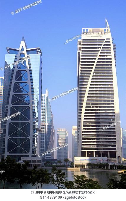 United Arab Emirates, U A E , UAE, Middle East, Dubai, Jumeirah Lake Towers, Indigo Icon, Dubai Arch Tower, tall building, skyscraper, residential, condominium