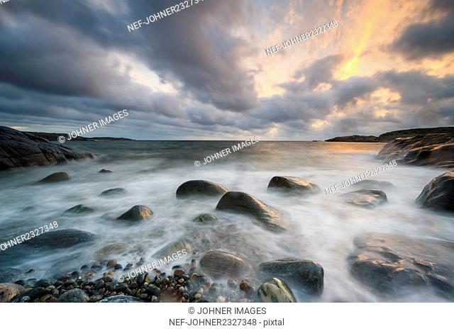 Sunset at rocky coast