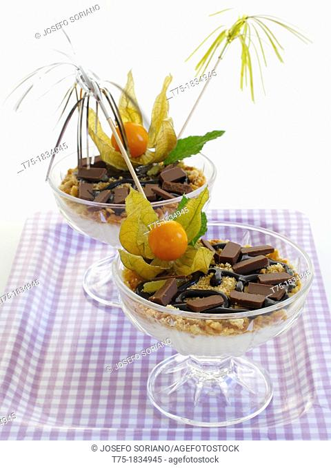 Natural yoghurt Cup with Biscuit and chopped almonds and two chocolates