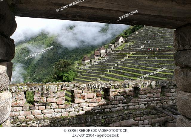 Terraces inside the archaeological complex of Machu Picchu. Machu Picchu is a city located high in the Andes Mountains in modern Peru