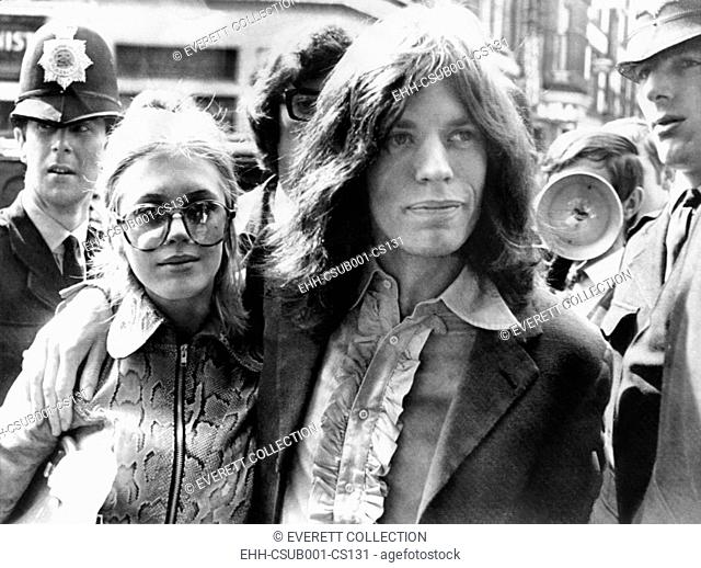 Mick Jagger and his girl friend, singer Marianne Faithful arrive at Magistrate's Court. The couple faced charges of possessing marijuana