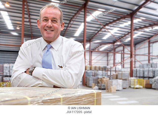 Portrait Of Businessman In Warehouse Dispatch Area