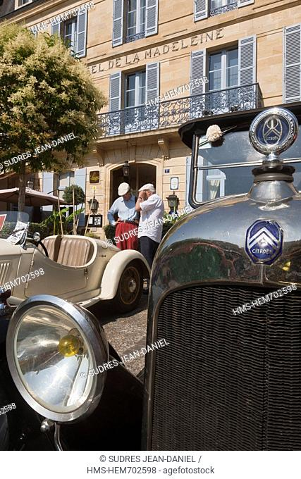 France, Dordogne, Sarlat, When passing a vintage car rally in front of Hotel de la Madeleine, the little place Rigaudie