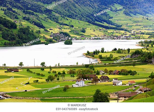The beauty of the Swiss landscape in the canton of Schwyz together with a lake that is named Lauerzersee