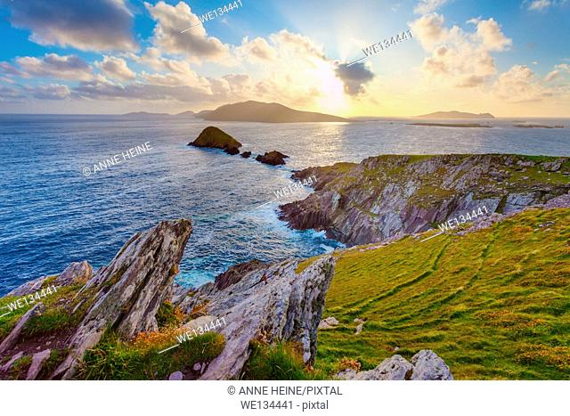 scenic irish west coast, looking from dingle peninsula (Europe`s most westerly point) in western ireland towards blasket islands while the sky is clearing up