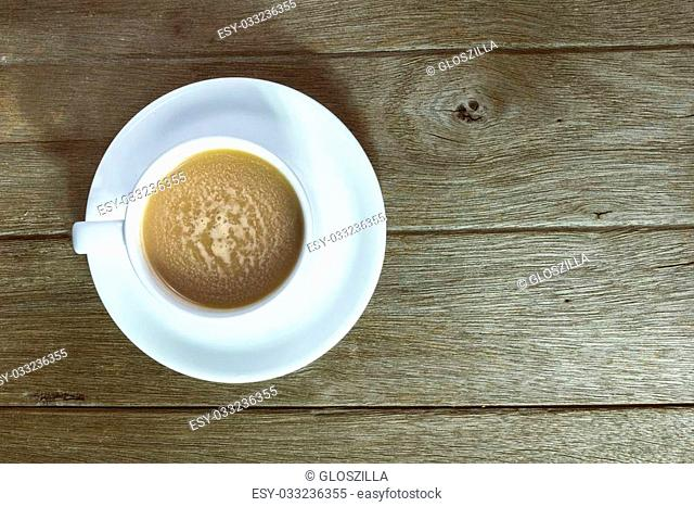 Coffee and sweets to tasty on a wooden floor