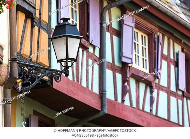 Close up of timbered houses and a lantern in Eguisheim, Alsace, France, Europe