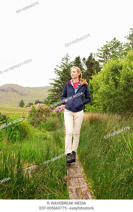 Blonde woman walking through the countryside
