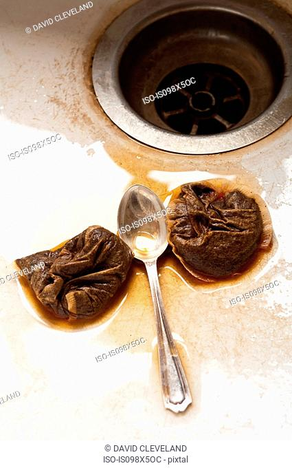 Teaspoon and teabags in kitchen sink