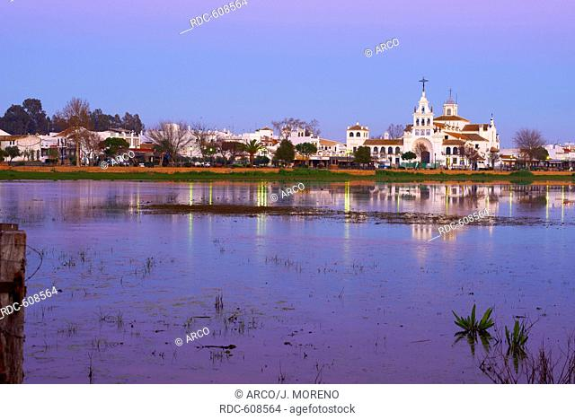 El Rocio village and Hermitage at Sunset, Almonte, El Rocio, El Rocio, Marismas de Donana, Donana National Park, Huelva province, Andalusia, Spain
